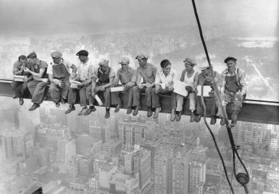 20 Sep 1932, Manhattan, New York City, New York State, USA --- Construction workers eat their lunches atop a steel beam 800 feet above ground, at the building site of the RCA Building in Rockefeller Center. --- Image by © Bettmann/CORBIS
